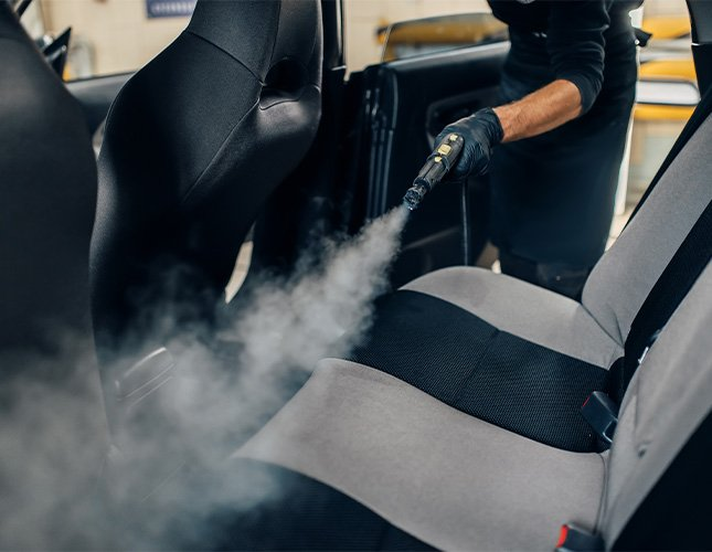 cleaning interior of car with a steam cleaner